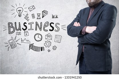 A man in suit on a concrete wall background with a business sketch on it