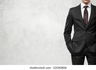 man in suit on a light concrete wall background