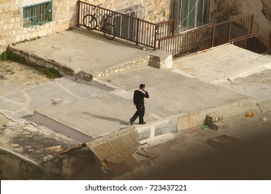 a man in a suit on the roof of the old city of Jerusalem