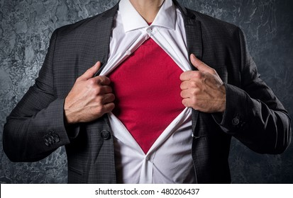 Man in suit opening his shirt