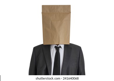 A Man in suit with a paper bag on his head isolated on white background