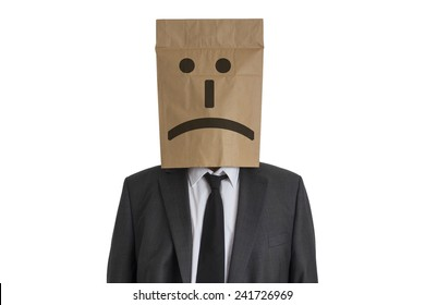 A Man in suit with a paper bag with sad smiley on his head isolated on white background