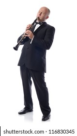 man in suit playing the clarinet isolated on white