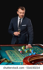 man in suit playing roulette. addiction to gambling.