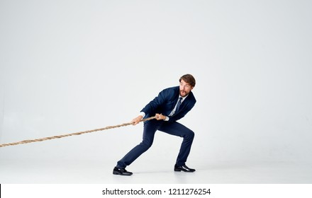 man in suit pulls the rope