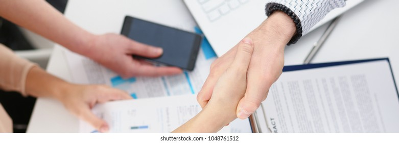 Man in suit shake hand as hello in office closeup top view. Friend welcome mediation offer positive introduction greet or thanks gesture summit participate approval strike arm bargain concept