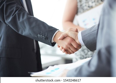 Man in suit shake hand as hello in office closeup. Friend welcome mediation offer positive introduction greet or thanks gesture summit participate approval motivation strike arm bargain concept.
