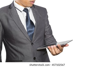 Man in suit, shirt and tie holding a tablet computer