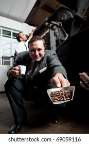 Man in suit showing freshly roasted coffee beans
