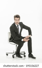 man in suit sitting on a chair  on isolated background