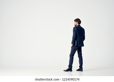 man in a suit is standing back