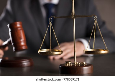 Man in suit, striking gavel. Lawyer concept.