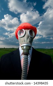 Man in suit and tie with gas mask and red hat against blue sky and clouds.