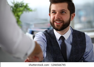 Man in suit and tie give hand as hello in office portrait. Friend welcome mediation offer positive introduction thanks gesture summit executive approval motivation male arm strike bargain