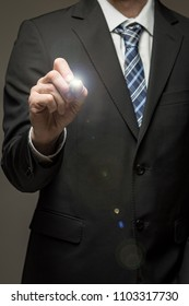 Man in suit touching virtual screen with pen tool