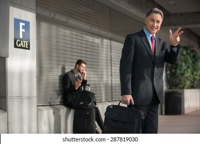 Man in suit traveling quickly and carrying light bag