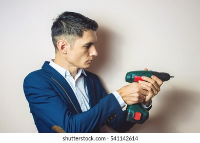 man in suit twists the screwdriver a screw. businessman for dirty work