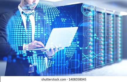 Man in suit using laptop computer in server room with double exposure of global business infographics hologram. Concept of market analysis and fintech. Toned image