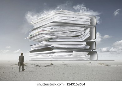 A man in a suit is walking towards a mountain of paperwork, daily grind concept