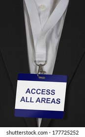 man in suite wearing an Access all Areas pass arround his neck