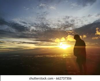 A man with the sun