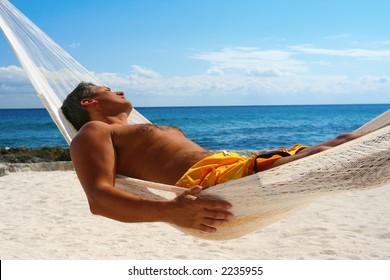 Man Sunbathing in a Hammock