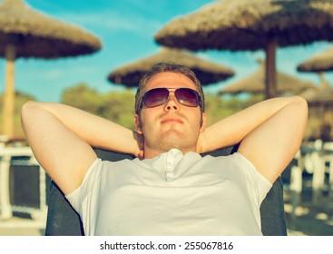 Man sunbathing on the beach vacation.