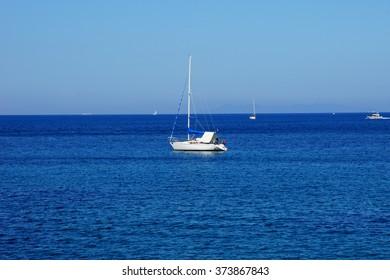 Man sunbathing on a yacht.