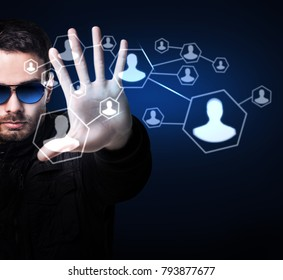 Man in sunglasses controls virtual system by hand.