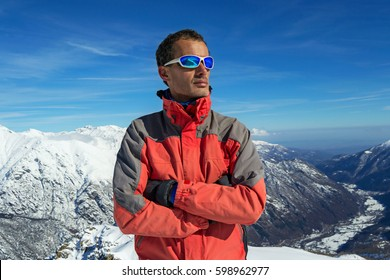 man with sunglasses looking at the top