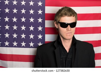 Man in sunglasses on a background of the American flag