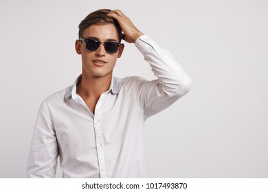 man in sunglasses on a light background