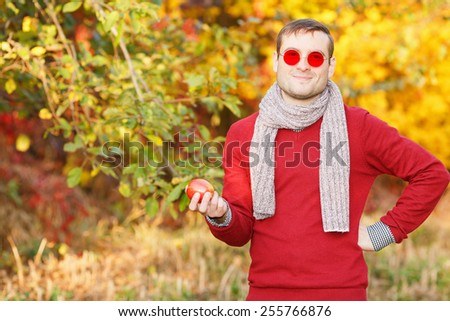75af828952b4 Man in sunglasses with red glasses. Ordinary people. A young man with a  beautiful