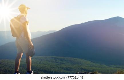 Man at sunset mountains