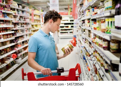 man in supermarket,  grocery store customer