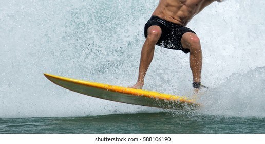A man surfing on white water and enjoying life