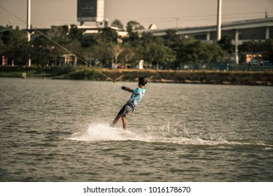 man Surfing at the water sports arena.