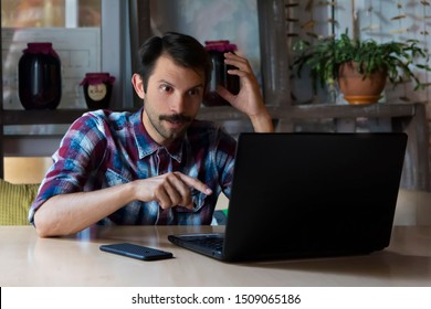 man is surprised to see the image on a laptop monitor obtained from the Internet