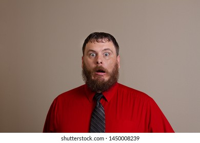 man surprised at what he sees but does not like it either
