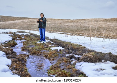 Man at the swamp using geolocation on smartphone