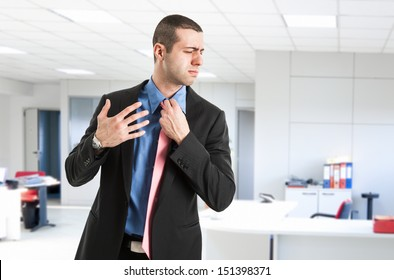 Man sweating in his office