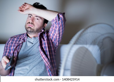 Man sweating and stressed during summer heat