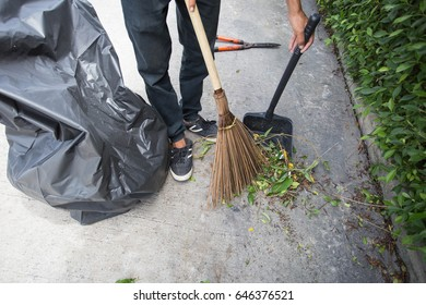 The man sweeping on the floor.