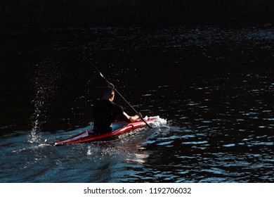 man swim with canoe