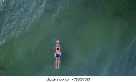 man swim in the sea, aerial view