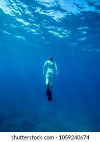 Man swimming with fins in ocean