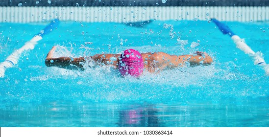 Man swims the butterfly in the pool