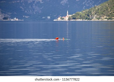 a man swims in the sea Kotor bay Montenegro