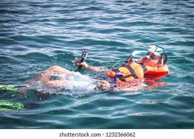 Man swinming  wear Life Jacket in sea   koh rok island Krabi Thaialnd