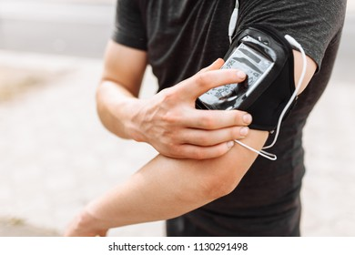 a man switches the music in a phone case, close-up